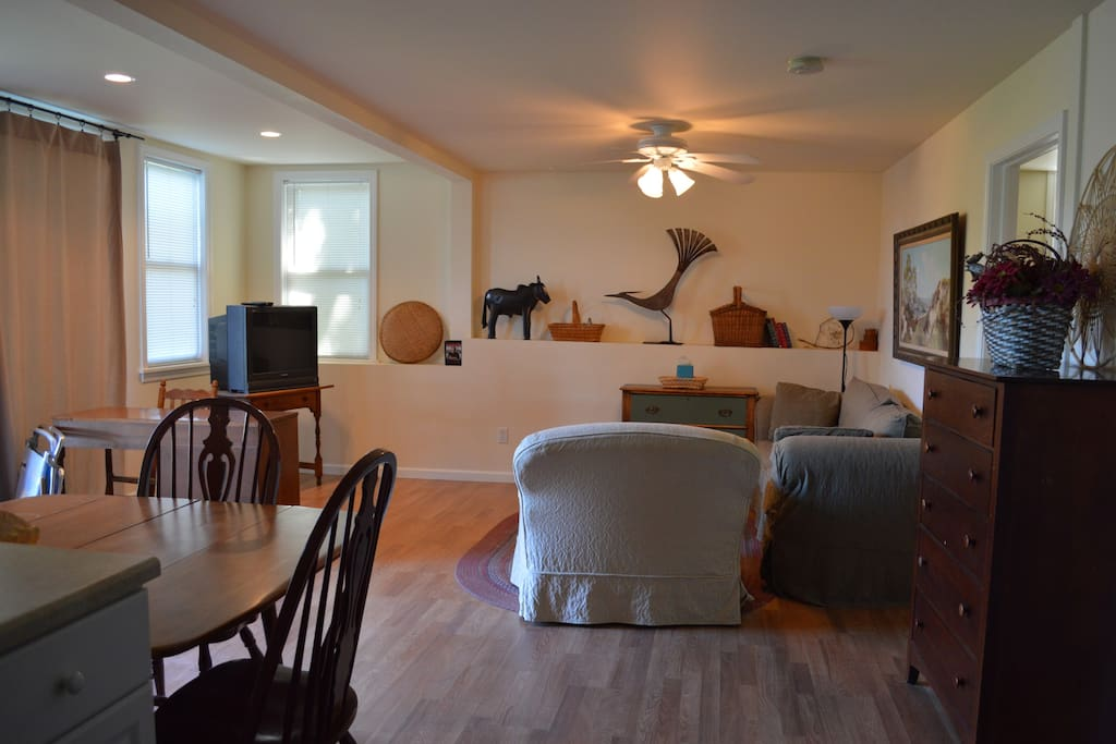 Private livingroom and kitchenette area with table.