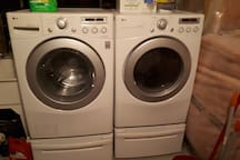 Basement laundry equipped with washer and dryer.