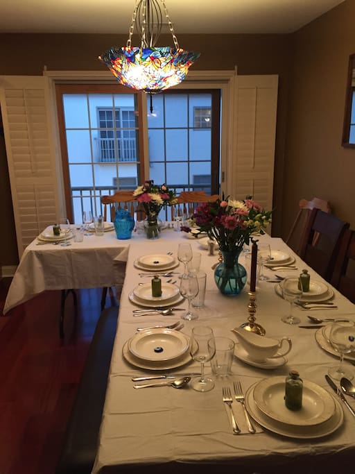 Normal kitchen table with additional folding table to accommodate 12 at a dinner party. Kitchen table typically seats 6 with 2 more seats at the island. 3 additional seats available to pull up to the table if needed.