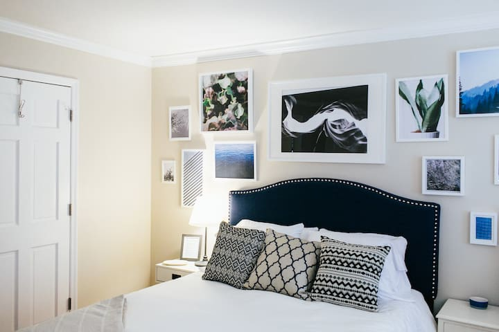 The Navy Room - Features a Queen bed, an ottoman, a full-sized closet empty for all of your things and its own bathroom.