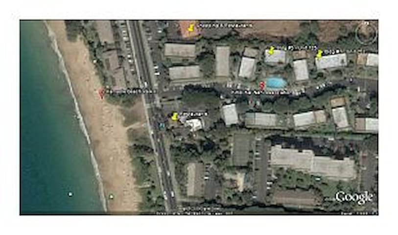 Arial photograph showing our condos, restaurants, shopping and Kamaole II beach accross the street.