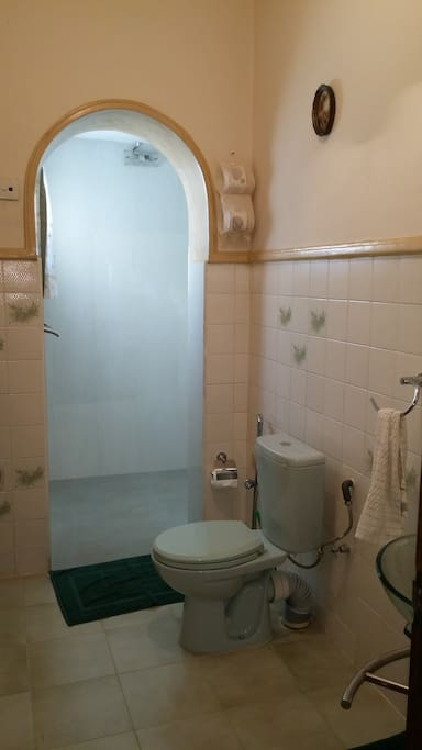Bathroom & shower area with hot & cold water