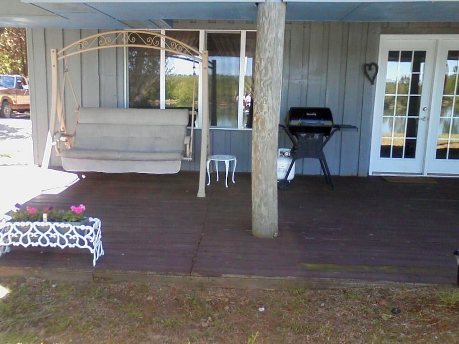 River Suite Entry with private deck, swing and grill overlooking the Savannah River