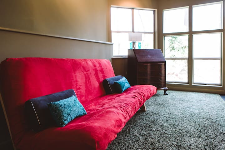 Full-sized futon may be used to accommodate additional guests.