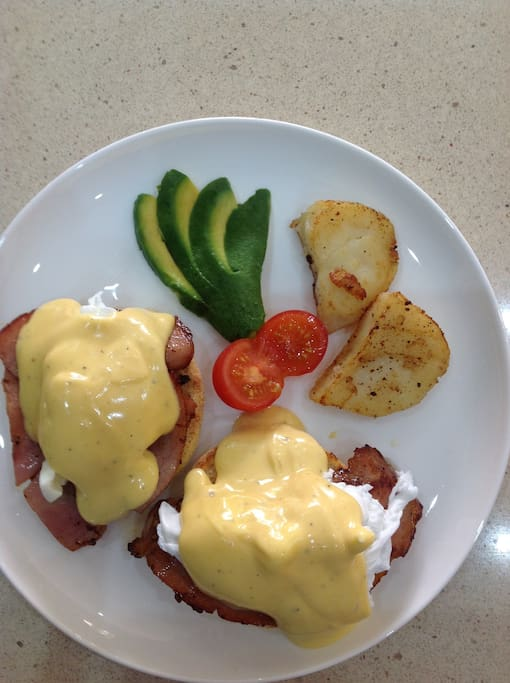 Breakfast included, photo of a guest's Eggs Benedict, a house specialty. Full menu avail
