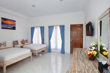 Twin bedroom with balcony near Uluwatu Beach
