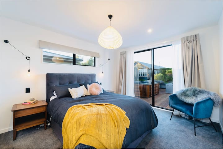 Master suite, includes walk-in wardrobe and large en-suite.  Opens onto the deck and spa.