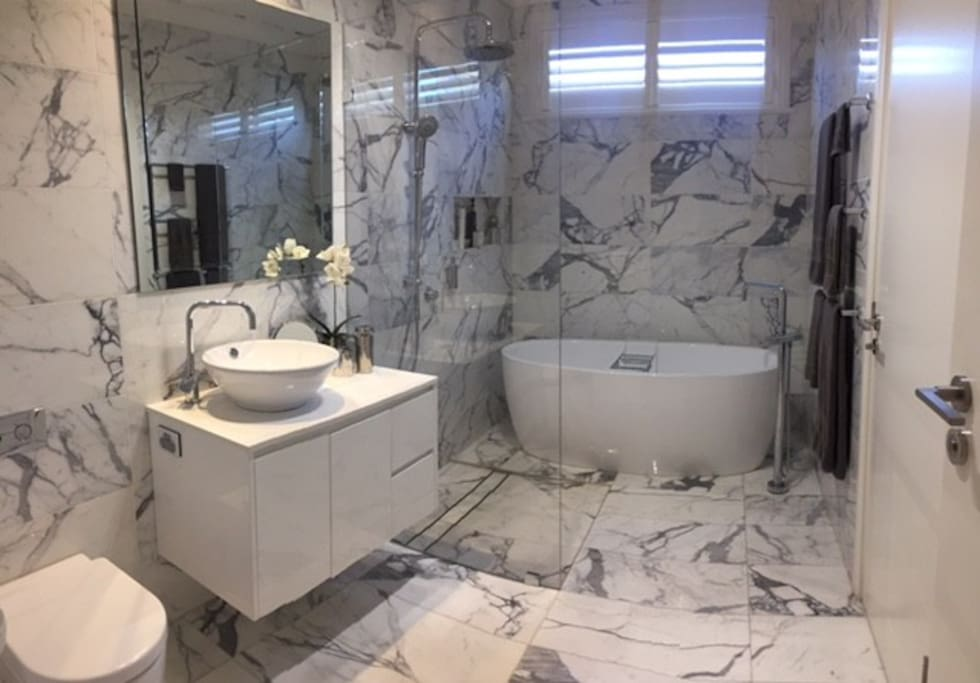 5 Star fully tiled Luxury marble bathroom with deep soaking bath