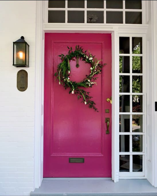 A cheery front door to welcome you! There's no mistaking you've arrived at the right place.