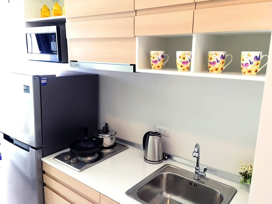 Kitchen. Kettle, pots, microwave, dishware and cookware set are provided.
