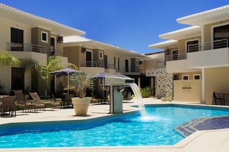 Casa luxuosa com 3 suítes, próxima à praia - Porto Seguro