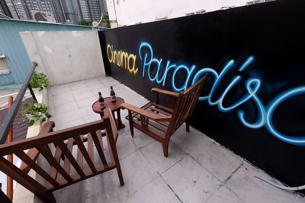 Outdoor area of the rooftop where you can watch the graffiti lighten under the neon performance of Landmark 81 tower.