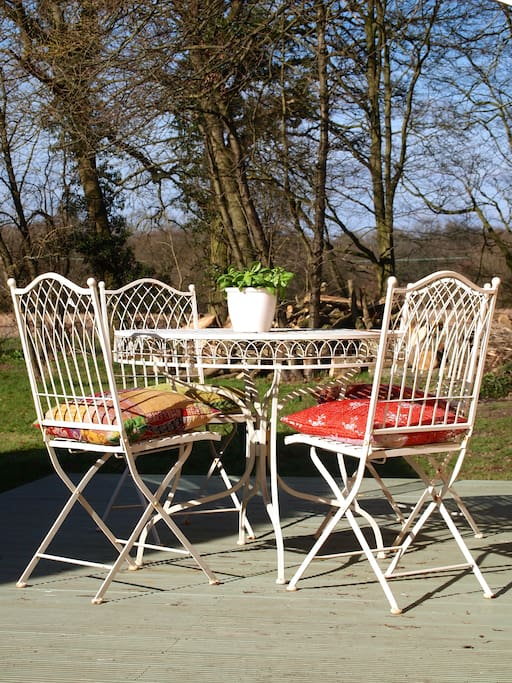 Decking with garden furniture.