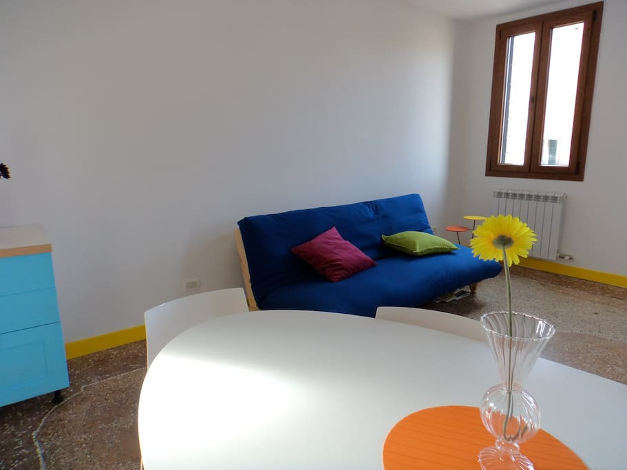 Living room, nice big table for 6 people, nice soft-bed double...