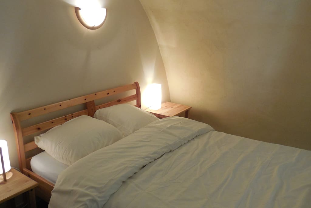 Sleeping in this comfy mezzanine bedroom cave is a joy! Access via spiral stairs.