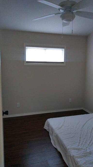 A simple, yet comfortable bedroom. Note: Bed is now on a bedframe.