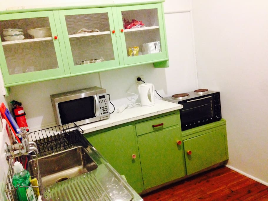 Kitchen has mini stove/oven/grill, Microwave, kettle, toaster and fridge.