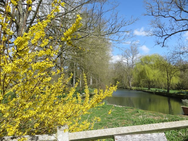 """The Mill Canal in spring. """"The grounds complete with ducks, chickens, dogs etc was brill and completely gorgeous, even in the rain!"""" Ellie."""