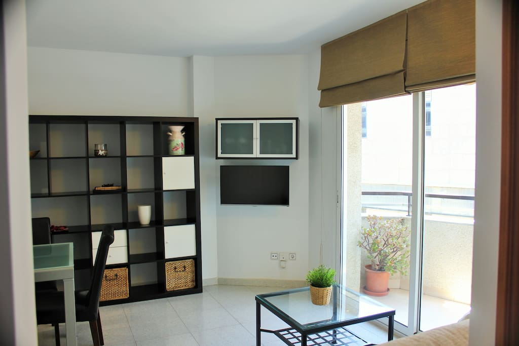 Dining room with flat TV and balcony