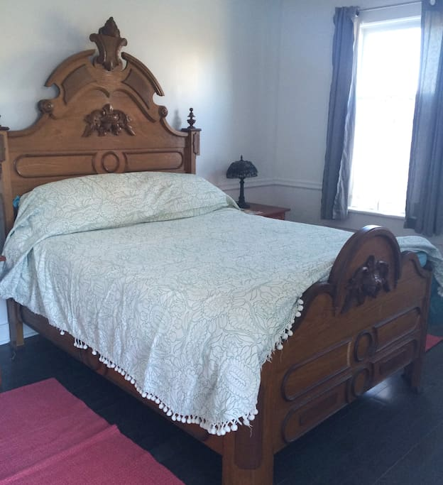 antique bed and coverlet.