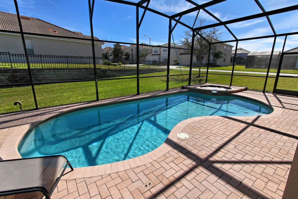 Sit and soak under the Florida sun on the cushioned deck loungers, or take a long cooling dip in the optionally heated pool.