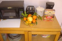 Assorted fruit from our citrus trees; and treats for our four legged hosts.