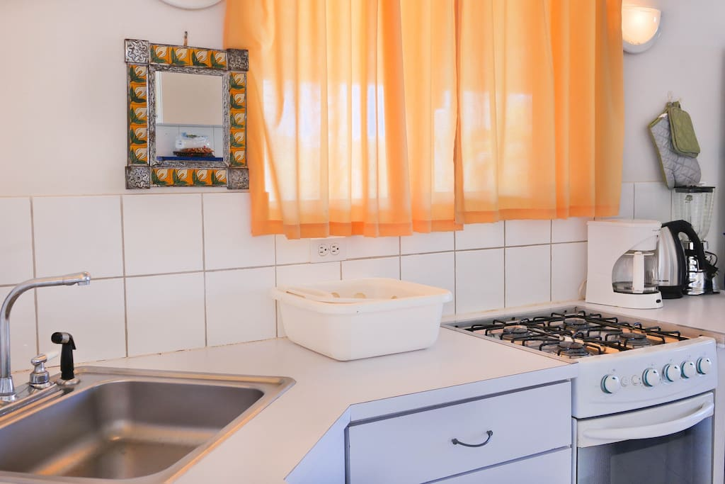 Fully equipped kitchen: dishwasher, full size refrigerator/freezer, electrical/gas cook top, gas baking     oven, microwave oven , coffeemaker, toaster, blender, all cooking and baking utensils, cutlery,      glassware, dinnerware and silverware