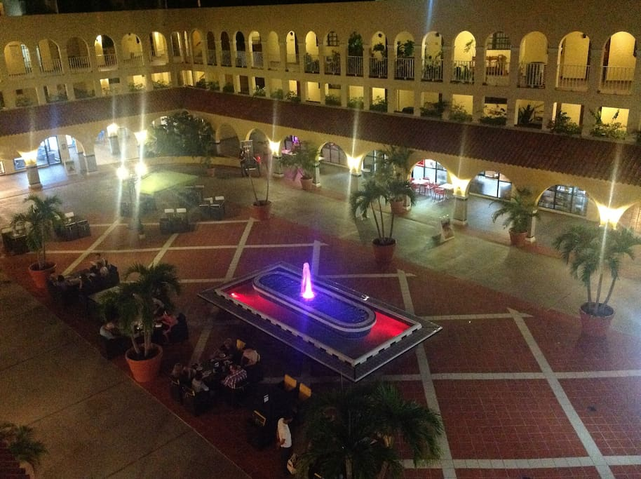 Plaza at night with fountain and water that change colors; 5 restaurants, food mart, pizzeria, bank and many ameniti.3