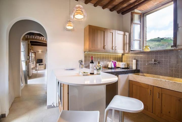 Kitchen with typical stone sink and dining table