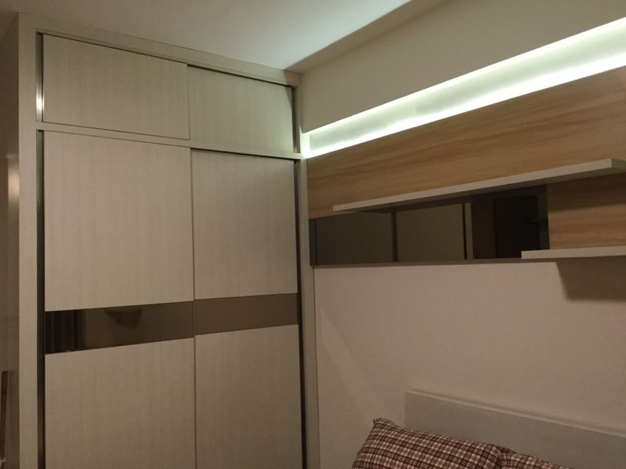 Wardrobe with hangers inside, you can put your suits, dresses, or your casual clothes inside