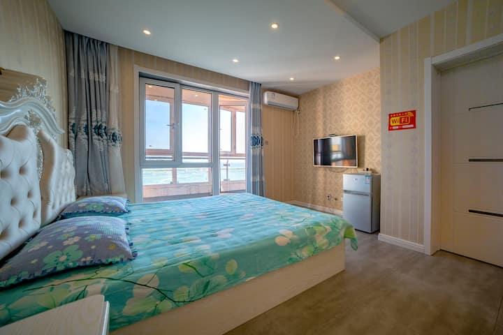 鲅鱼圈区金泰城海岸线,雨航海景公寓山海广场店,单室海景双床房