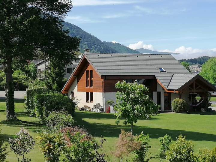 House with wood structure in the Alps