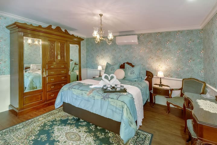 Beautiful bedroom taking in the outdoor views and romantic cupid chandeliers. Beautiful antique wardrobe makes this truly special. BLUETOOTH speaker