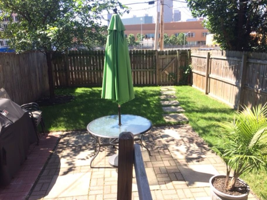 Our backyard oasis! Two private parking spots are directly behind the fence