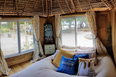 Exclusive Beachfront Native Bamboo Cottage & Huts
