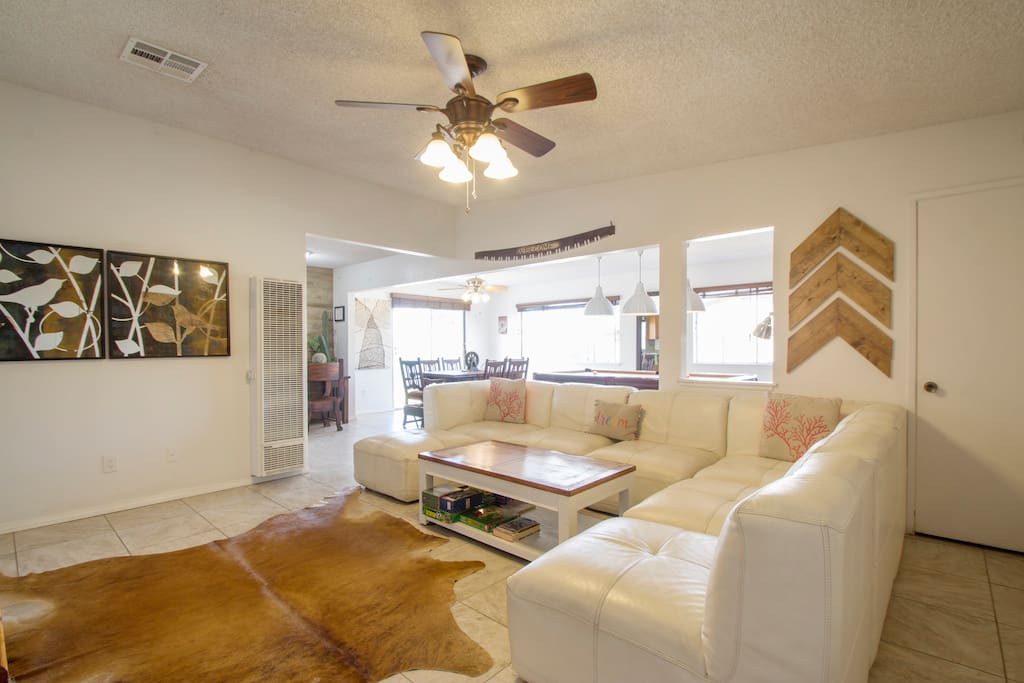 Open floor plan, cow skin rug and cozy leather couch that can serve as a queen size bed.