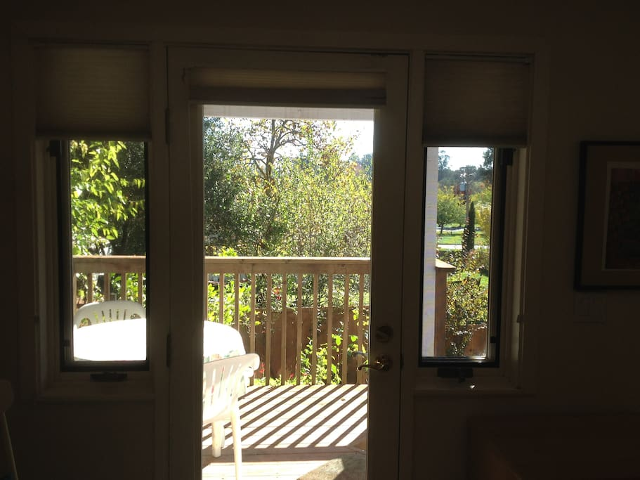 View of outside private deck,  shades open, locked entrance