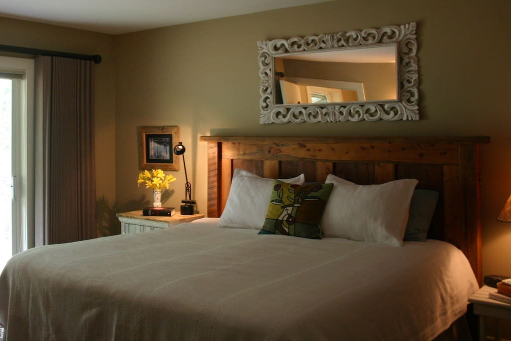 Luxurious King bed in upstairs Bedroom #1 with ensuite.