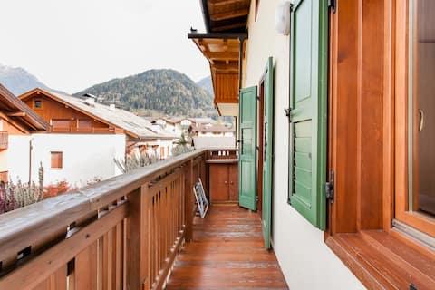 Warm appartement in blokhutstijl met uitzicht op de Dolomieten