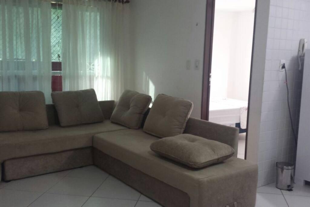 Vista da sala do Flat sofá cama aberto