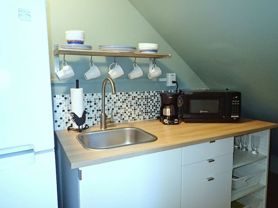 Modern kitchenette with microwave, toaster, coffeemaker and electric kettle (no stove or oven cooking)