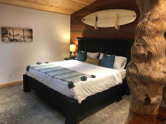 The bed ,seen as you walk in the cabin.