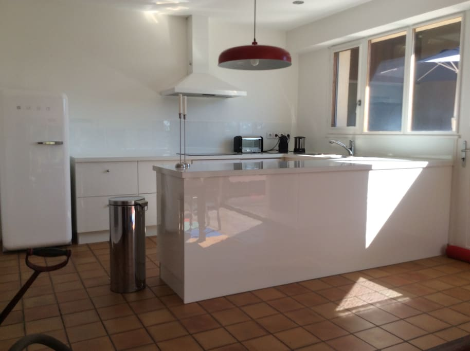 Open kitchen with all equipment (oven, american fridge, dishwasher)
