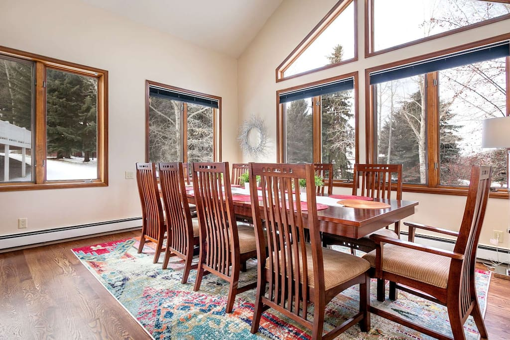 Gather around the dining table for family games or meals at this large dining table for 10-12 guests.