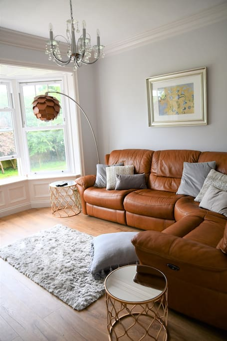 Lounge with recliner corner sofa and bay windows