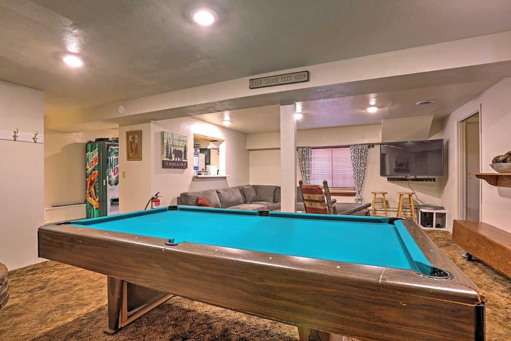 Enjoy shooting pool downstairs with your group in the game room of the cabin.