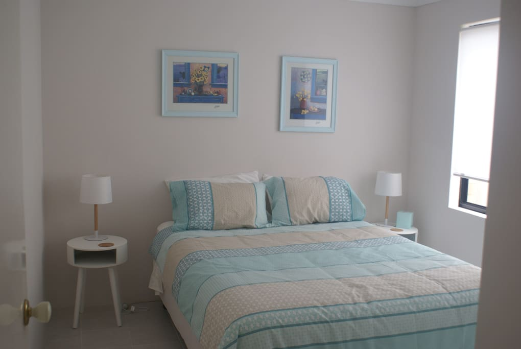 One of 3 queen size bedrooms with built in robes.