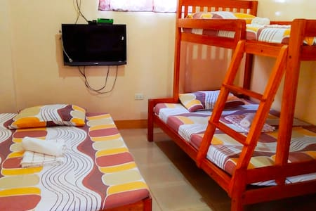 Studio type bedroom, 8 pax capacity with 2 bathrooms, cable tv, with kitchenette, beach front aircondition room.
