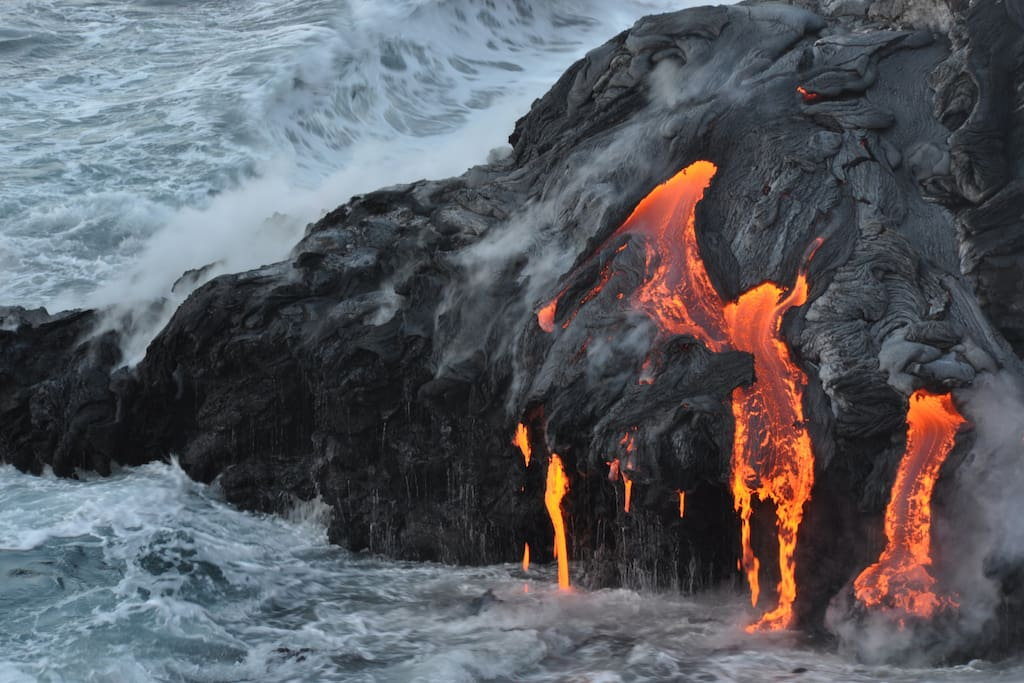 The fresh lava flows into the ocean at certain times & places