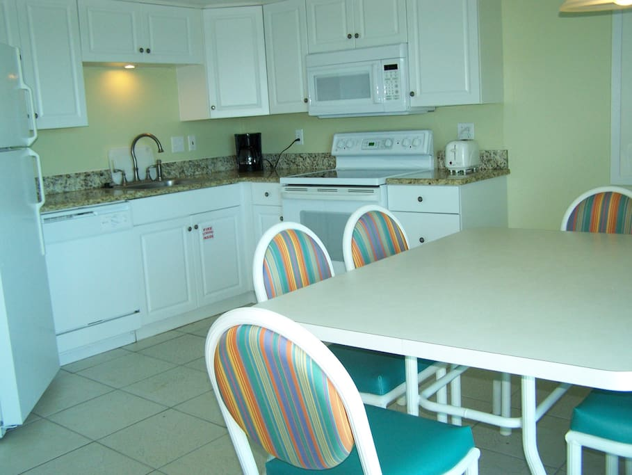 Fully Equipped Kitchen with Bright Dining Area